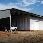 Steel agricultural shop with garage doors