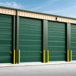 Steel storage units with green garage doors