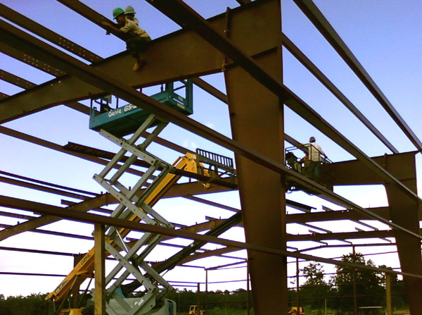 Red steel framing under construction
