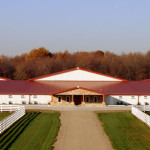 Beautiful Metal Horse Barn / Steel Horse Barn with White sides and Red Roof Top