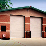 Steel automotive lube shop with brick walls and garage doors