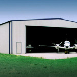 Steel airplane hangar building with airplane