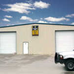 Tan steel auto repair shop with garage doors