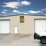 Tan steel auto repair shop with garage doors