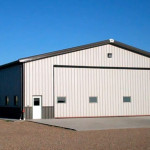 Large steel equipment storage and workshop with 30' Door