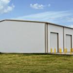Industrial white steel building with garage doors