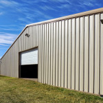 Tan steel agricultural storage building