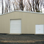Tan steel home storage building with double door and garage door