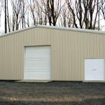Tan steel home storage building with double door and garage door