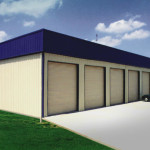Steel storage building with garage doors and blue roof