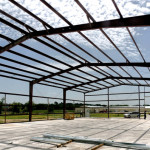 Red iron framing of steel building under construction