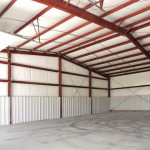 Inside of building with red steel framing and insulation