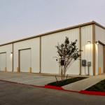 Steel building with garage doors and parking