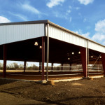 Covered horseback riding arena with skirt
