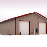Equipment storage building with garage doors in the snow