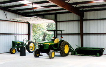 agricultural steel building with two tractors inside