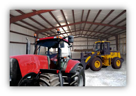 red and yellow tractors in a steel building