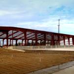 Red steel framing under construction