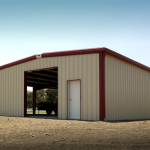 Tan and red steel equipment storage building