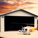 Steel hangar with helicopter and garage door