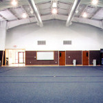 Interior of martial arts facility with blue carpet