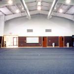 Interior of martial arts facility with blue carpet