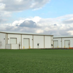 Two white industrial steel buildings