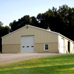 Steel tan ranch shop building with garage door
