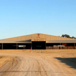 Covered cattle and livestock steel building