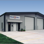 Polar Com's Steel Building with 2 Large Roll Top Garage Doors and Multi Framed Openings