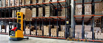 forklift working inside a steel warehouse