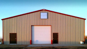 tan metal barn with dark red trim