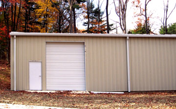 tan and white multi-use metal garage