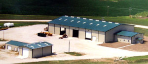 several steel industrial buildings with bright blue metal roofing