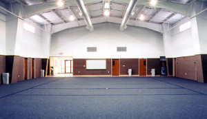 inside a RHINO recreation building with blue indoor/outdoor carpet
