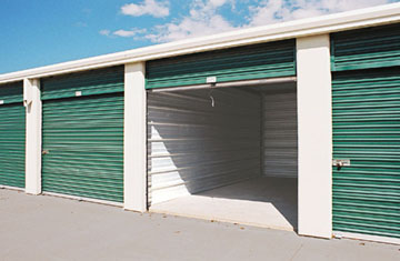 green and white metal storage buildings for self-storage