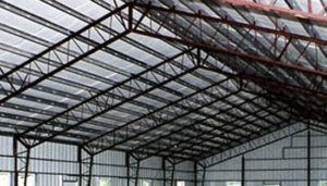 Photo of web truss style steel building.