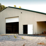 Steel building shop with implement covered storage