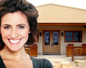 Smiling woman in front of her tricked out backyard getaway.