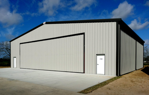 RHINO Metal Aircraft Hangar with personnel doors