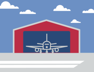 Icon of an airplane in a metal aircraft hangar.