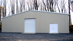 Photo of a large metal storage building with an overhead door.