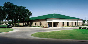 photo of a RHINO commercial building  with a green metal hip roof.