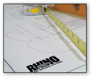 Image of RHINO metal building plans and tape measure.