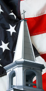 A church steeple and an American flag denotes steel church building in the U.S.