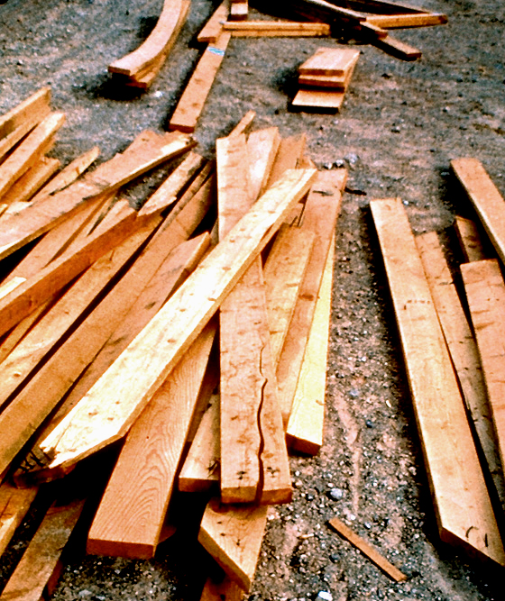 photo of a pile of split, warped, and discarded lumber