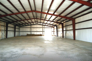 Photo of the interior of a newly finished RHINO metal building.