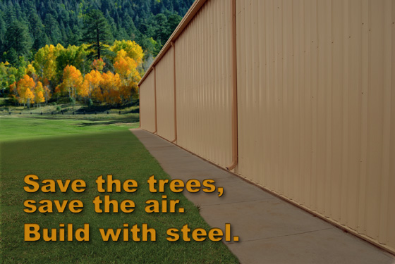 The side of a metal building in an area before a forest with the heading: Save the Trees, Save the Air.  Build with Steel.