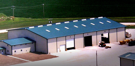 Large industrial metal building with bright blue roofing and trim