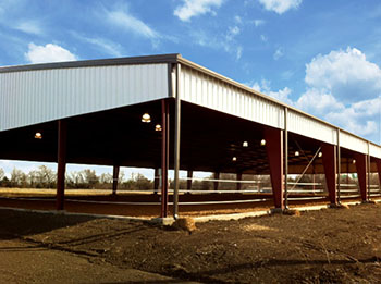 Photo of a RHINO open-air metal building used as a horse riding arena